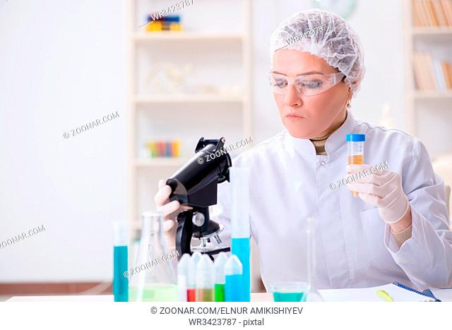 Doctor with test tube in medical hospital lab