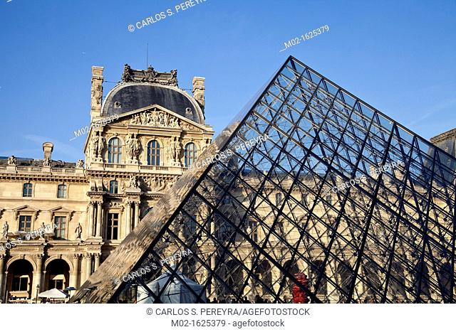 Glass pyramid entrance in front, Palais du Louvre or Louvre Palace museum in the evening light, Paris, France, Europe
