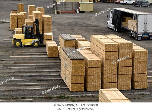 Fork lift loading truck at sawmill, Coos County, Oregon