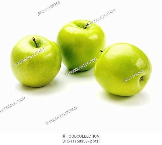 Three apples of the variety 'Granny Smith'