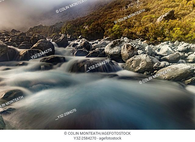 Mungo river rapids, afternoon light breaks through heavy mist, West Coast, New Zealand