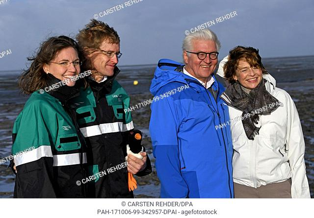 German federal president Frank-Walter Steinmeier (2-L) and his wife Elke Buedenbender (L) can be seen standing in the mud flats with the prime minister of...