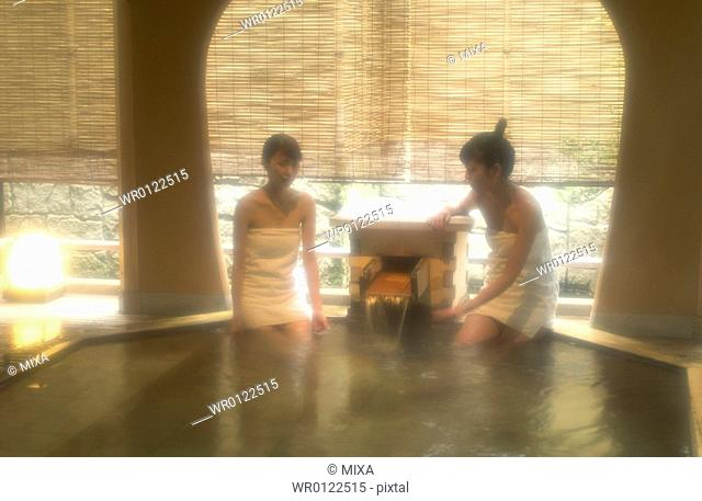 Two young women bathing in hot springs