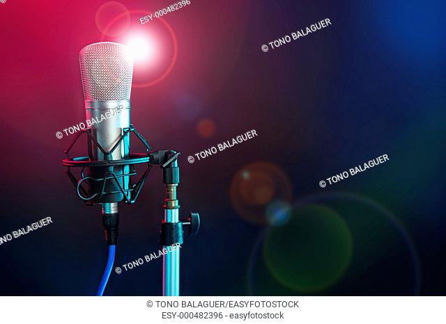 Microphone in the night colorful light in a recording studio