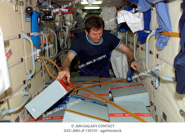 Cosmonaut Sergei Y. Treschev, Expedition Five flight engineer representing Rosaviakosmos, checks stowage boxes in the functional cargo block (FGB), or Zarya