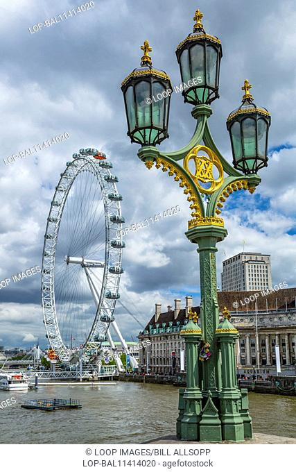 Street lamps on Westminster Bridge and the London Eye