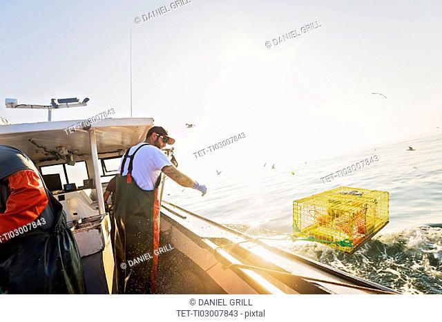Fisherman working on fishing boat