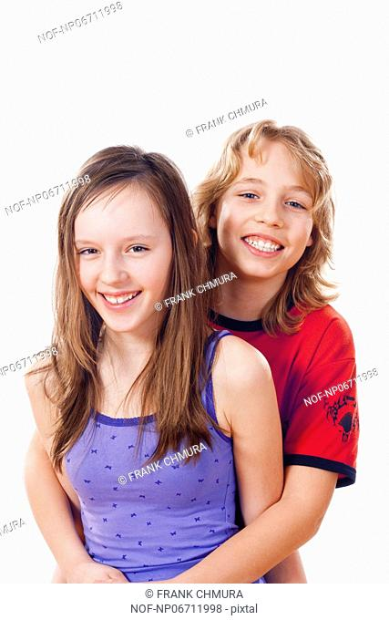 portrait of a boy and girl smiling - isolated on white