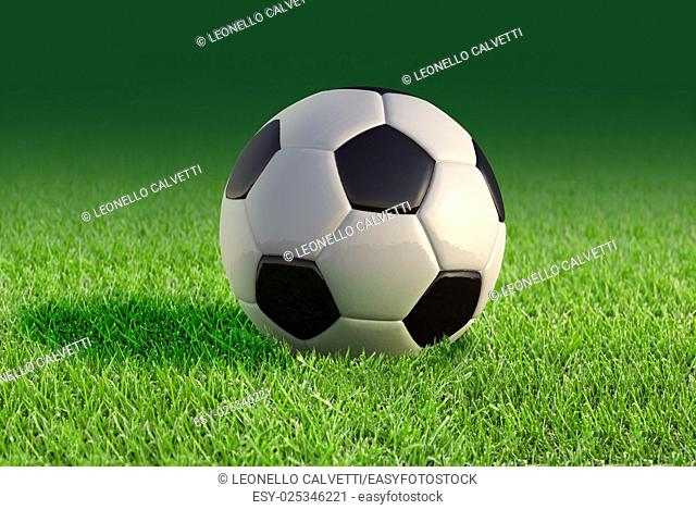 Soccer ball close up on grass lawn, with fading green background