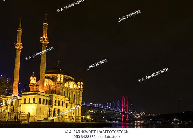 Istanbul, Turkey The Ortaköy Mosque under the Bosphorus Bridge, known officially as the 15 July Martyrs Bridge and unofficially as the First Bridge