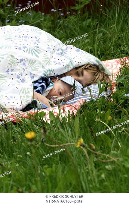 Mother and child laying in the grass Sweden