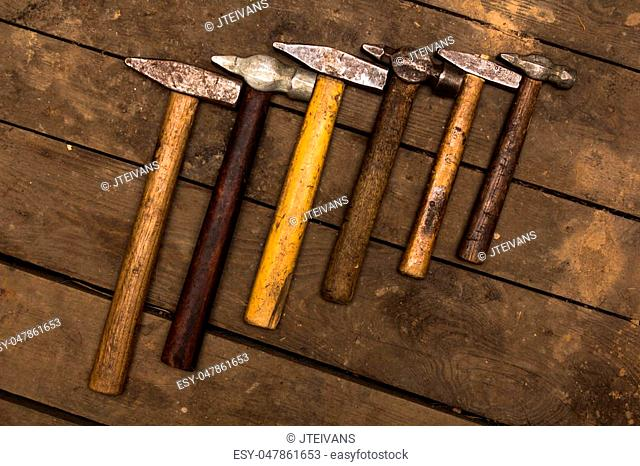 six hammers on wooden surface
