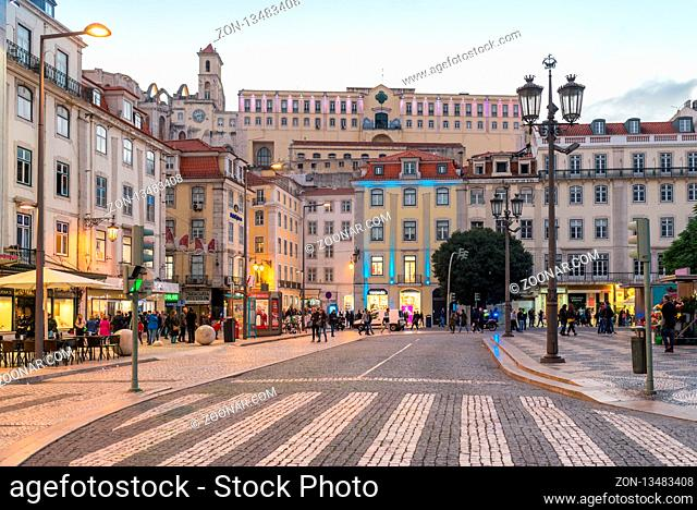View from the Rossio square up to the Carmo convent situated in the upper district Bairro Alto