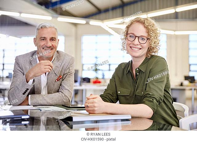 Portrait smiling business people in meeting