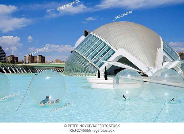 Children inside a water walking ball at the science park in front of the Hemisferic iMax building at Valencia