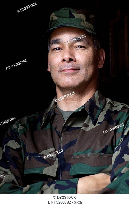 Portrait of mature man wearing military uniform