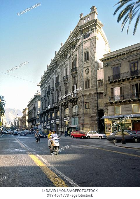 South along classical buildings of the Via Roma near junction with Via Bandiera in central Palermo, Sicily, Italy