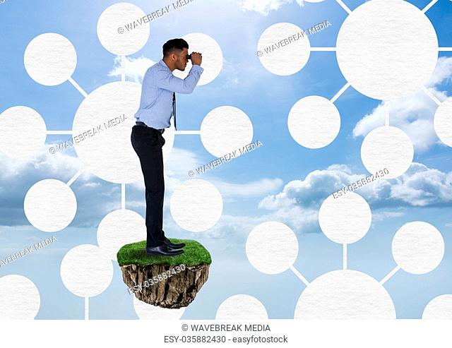 Businessman with binoculars on floating rock platform with interface mind maps in sky