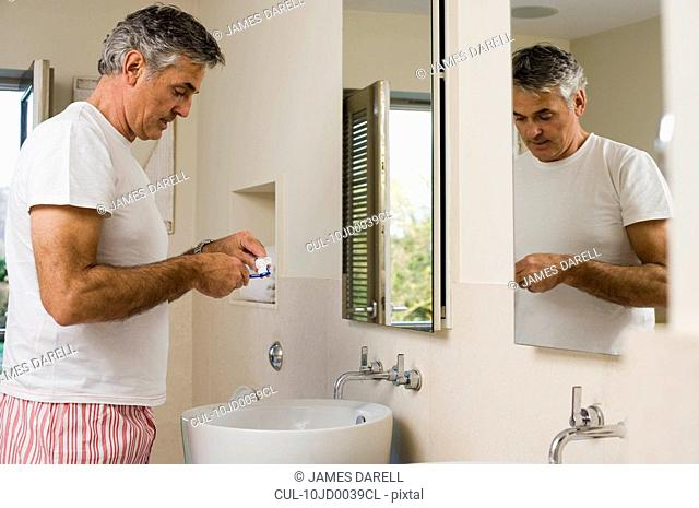 Man about to brush teeth