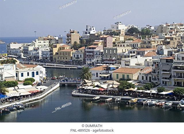 High angle view of lake in city, Lake Voulismeni, Agio Nikolaos, Lasithi Prefecture, Crete, Greece