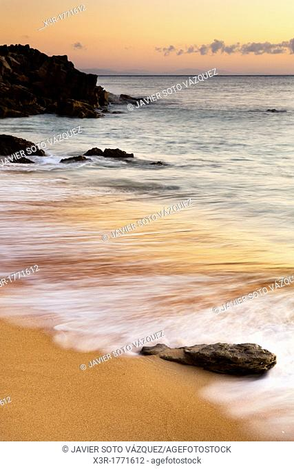 Rocky beach at sunset at south of Spain