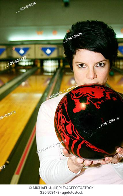 Woman with bowling bowl