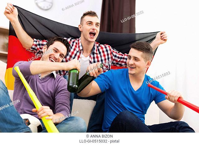 Germany men celebrating win of favorite football team. Debica, Poland