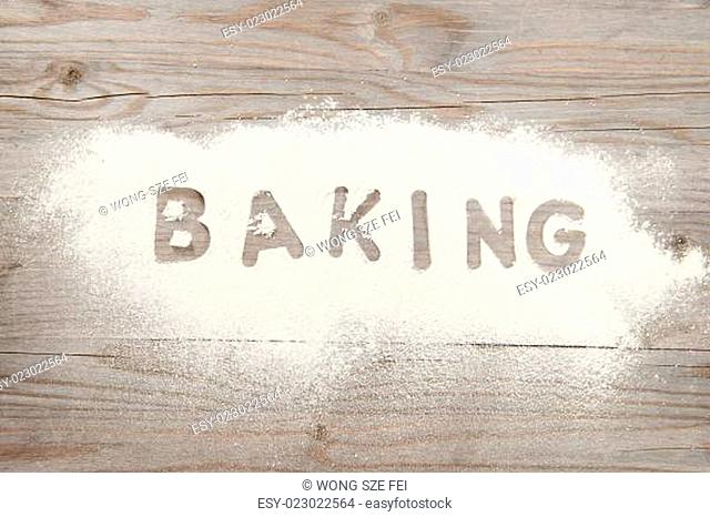 Word baking written in flour