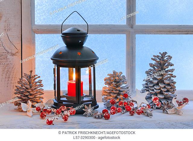 lantern on windowsill with christmas decoration