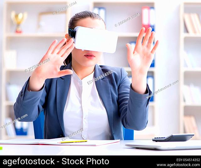 The businesswoman with virtual reality glasses in office