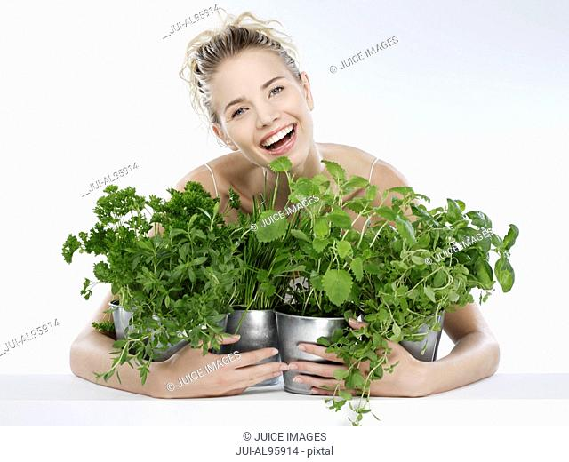Young woman with herbs