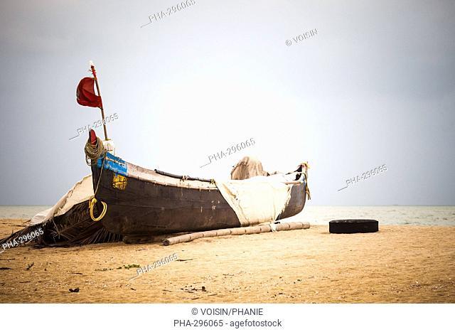 Fishing boat on a beach in Kerala, India
