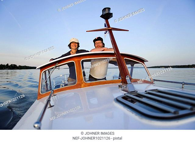 Mature couple travelling in motorboat, portrait