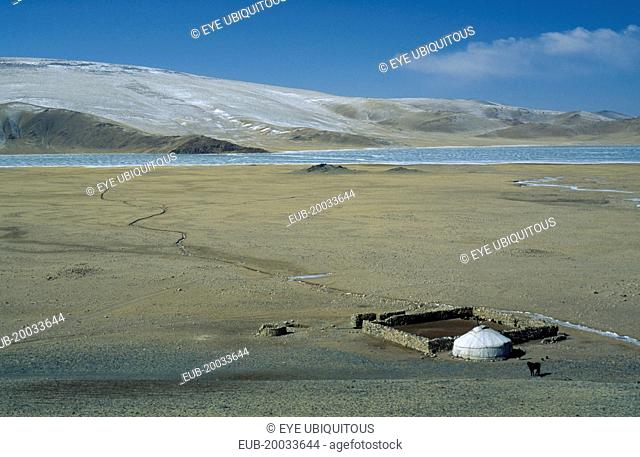 View over Kazakh nomad camp with single yurt and surrounding landscape