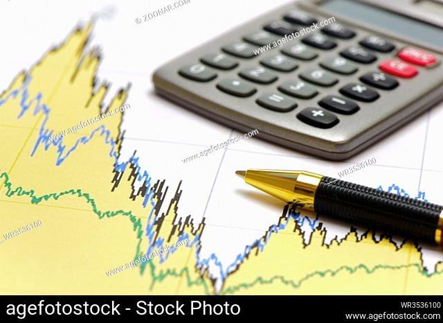 financial chart of stock market with pencil
