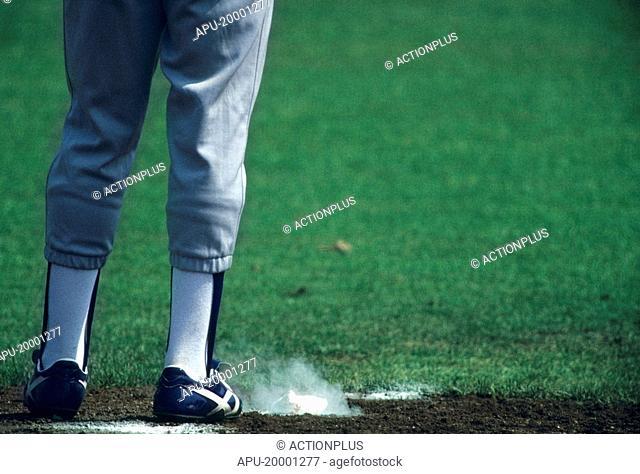 Baseball player standing by pitchers chalk bag