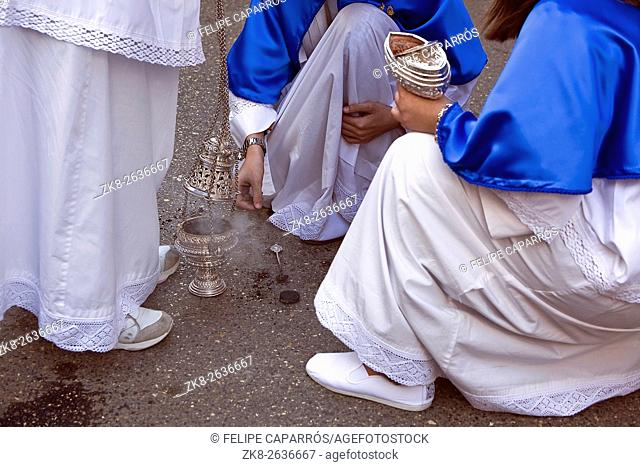Several altar boys burn incense in a procession of Easter, Andalusia, Spain