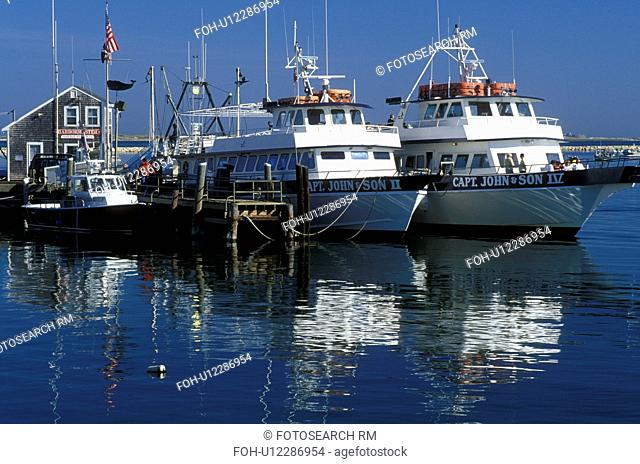 boats, Plymouth, Massachusetts, MA, View of Captain John Whale Watching boats docked in Plymouth Harbor in Plymouth