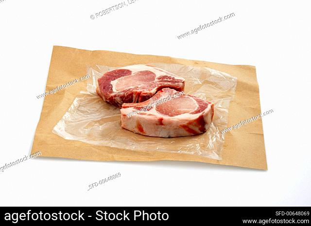 Two Raw Pork Chops on Butcher's Paper