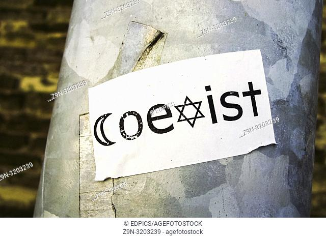 "sticker saying """"coexist"""" using the star of david and the crescent as """"c"""" and """"x"""" respectively, stuttgart, baden-wuerttemberg, germany"