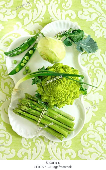 Assorted green vegetables on porcelain plate