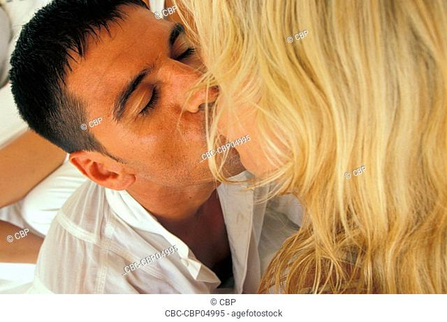 Portrait of a Young Couple Kissing