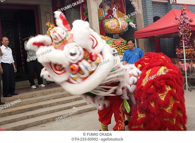 Lion dance at the Tin Hau temple of Joss House bay celebrating the Tin Hau festival, Hong Kong