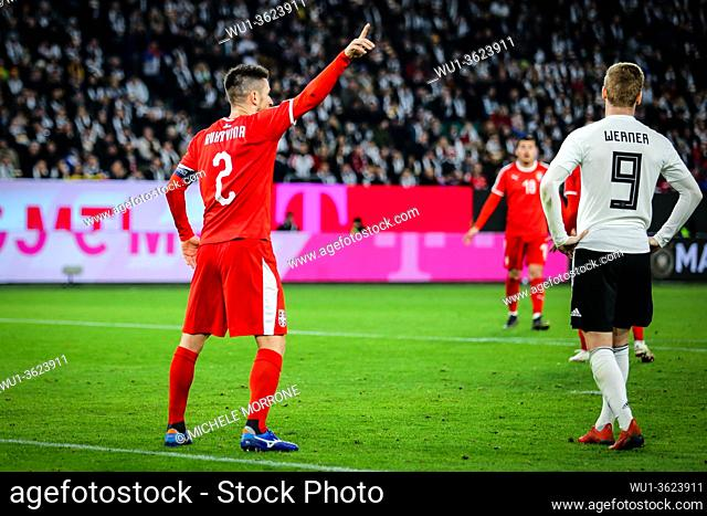 Wolfsburg, Germany, March 20, 2019: Serbian national team captain Antonio Rukavina directs his teammates during the international friendly game Germany vs...