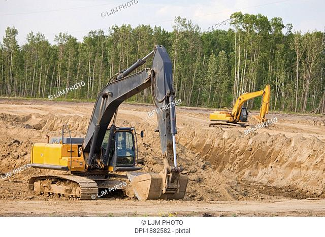 Road Construction Using A Backhoe, Edmonton, Alberta, Canada