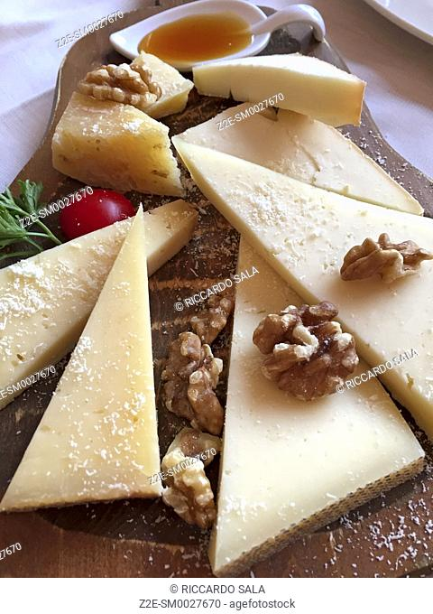 Italy, Lombardy, Tirano, Cheese Platter with Walnuts
