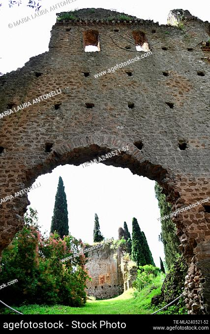 Apse with frescoes of the church of Santa Maria Maggiore. The garden of Ninfa ( Giardino di Ninfa) typical English garden started by the owners Caetani in 1920...