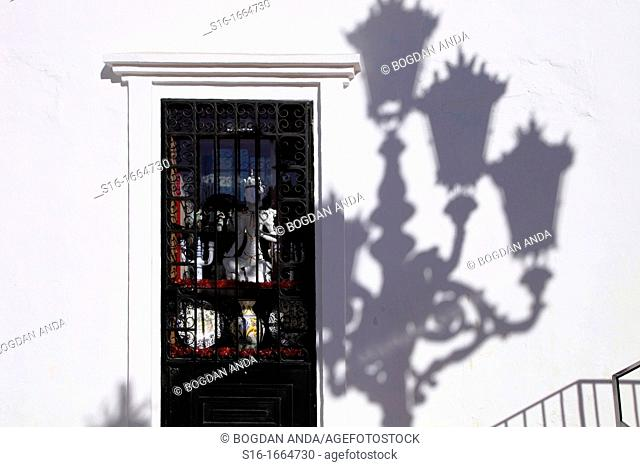 Mijas Pueblo, Spain, Malaga province, Andalusia, Costa del Sol - Shop window with a display of Buddhist objects, accompanied by matching shadows pattern of a...