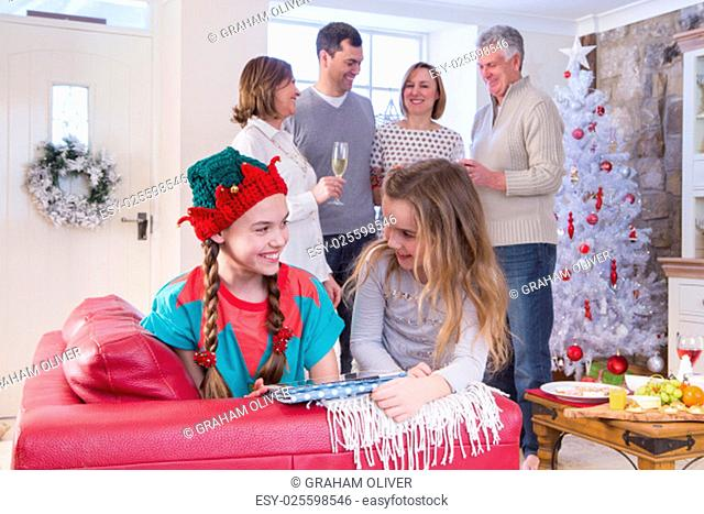Three Generation Family at Christmas. They look happy and are celebrating together