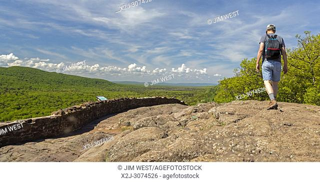 Ontonagon, Michigan - 71 years old man hikes on the escarpment above Lake of the Clouds in Porcupine Mountains Wilderness State Park